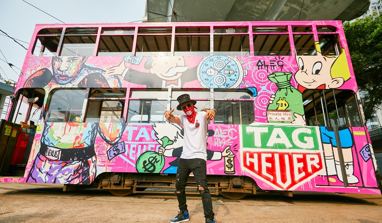 Alec Monopoly with the graffiti-covered Hong Kong tram