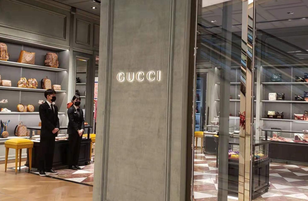 Gucci store in Shanghai with staff wearing surgical masks